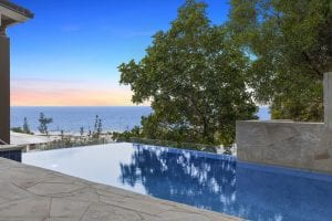 Outdoor pool overlooking sea